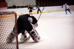 Hockey goalkeeper in generic black equipment Stock Images