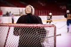 Hockey goalkeeper in generic black equipment Stock Photo