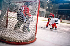 Hockey goals, shoots the puck and attacks goalkeeper. Hockey goals, players shoot the puck and attacks goalkeeper royalty free stock images
