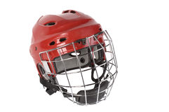 Hockey helmet. Red helmet for hockey, is designed to protect the head, is used in competitions, the mask protects the face of an athlete, protects the face and Stock Photo