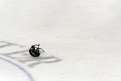 Hockey helmet. A lone hockey helmet left on the ice after a game royalty free stock image