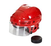 Hockey helmet and puck Royalty Free Stock Image