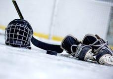 Hockey Helmet, Puck, Stick and Skates on Hockey stock photos