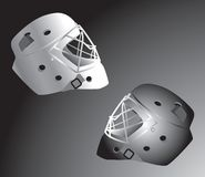 Hockey helmets on black background. Hockey helmets facing one another. Black and white gradient background Royalty Free Stock Photos