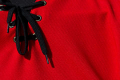 Hockey jersey. Red hockey jersey closeup for sports background Royalty Free Stock Image