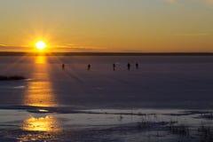 Hockey. Kids play hockey on the lake Stock Photography