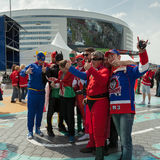 The hockey Latvian fans in superheroes costumes Stock Photo