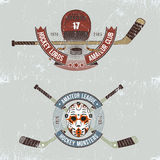 Hockey logos. In grunge style. Logos for hockey events, teams with sticks, helmets, ribbons and labels.Grange layer can be easily removed Stock Illustration