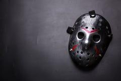 Hockey mask of serial killer isolated on black Royalty Free Stock Photos