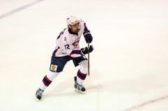 Hockey met de puck Royalty-vrije Stock Afbeelding