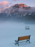 Hockey in the Mountains. A mountain lake hockey rink at sunrise in mid winter royalty free stock photography