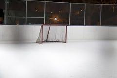 Hockey net. Photo of a hockey net on an outdoor rink at night Stock Photos