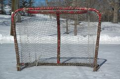 Hockey net. Outdoor hockey rink with nets covered in snow royalty free stock photos