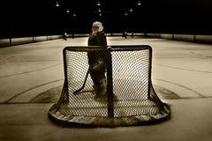 Hockey net. Goalie looking back behind the net Stock Photo