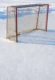 Hockey net. Empty Hockey net on shinney rink, copyspace below Royalty Free Stock Image
