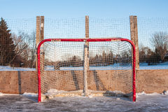 Hockey Net. In the backyard rink in winter time Royalty Free Stock Photo