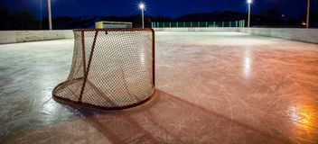 Hockey net on an outdoor rink. Hockey net on an outdoor ice surface in Quebec at night Stock Photography