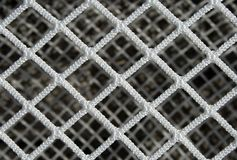 Hockey net pattern. Close of a new hockey goal net, forming a symmetric pattern stock image
