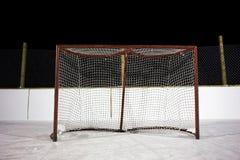 Hockey net. Rusty hockey net outdoor rink at night Royalty Free Stock Photos