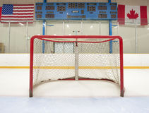 Hockey net with scoreboard. Ice hockey empty net with scoreboard in the background Royalty Free Stock Photo