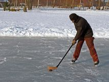 Hockey op vijver Stock Afbeelding