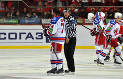 Hockey palyer and referee Stock Photos