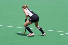 Hockey Player. Field hockey player running the ball Stock Photos