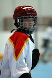 Hockey Player. Young boy playing hockey with helmet on Stock Images