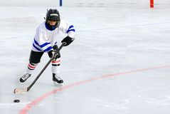 Hockey Player. Six Year Old Hockey Player Racing with the Puck stock image