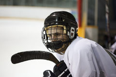 Hockey player. Ice hockey player on the bench inbetween shifts royalty free stock photos