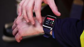 Hockey player checking activity on smartwatch stock footage