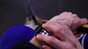 Hockey player checking heart rate on smartwatch before training. stock video