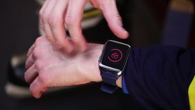 Hockey player checking heart rate on smartwatch before training. stock footage