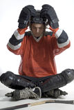 Hockey Player Cross-legged-Vertical Stock Photos