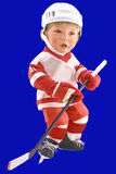 Hockey Player Doll. Isolated on blue background Royalty Free Stock Images
