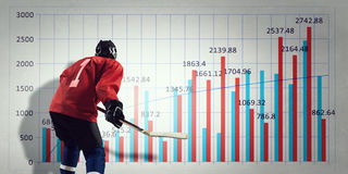 Hockey player and dynamics graph . Mixed media. Ice hockey player and graphs at background royalty free stock images