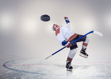 Hockey player fall dawn on ice Royalty Free Stock Photos