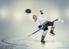 Hockey player falls down on ice Royalty Free Stock Photography