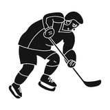 Hockey player in full gear with a stick playing hockey.Winter active sport.active sports single icon in black style Stock Photography