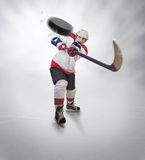 Hockey player gives powerful pass Stock Photos