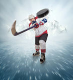 Hockey player gives powerful pass Royalty Free Stock Photos