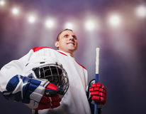Hockey player with helmet in hands : moment of glory Stock Photo