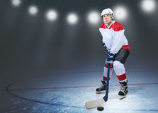 Hockey player on the ice. In stadium lights royalty free stock images