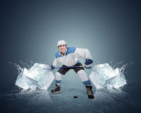 Hockey player with ice cubes Royalty Free Stock Photography