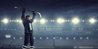Hockey player on ice   . Mixed media Royalty Free Stock Photography