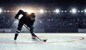Hockey player on ice . Mixed media stock photography