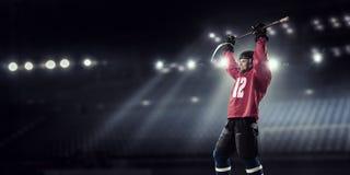 Hockey player on ice . Mixed media royalty free stock image