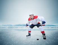 Hockey player on the ice surface of lake Royalty Free Stock Photo