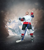 Hockey player portrait on abstract ice background stock images