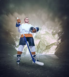 Hockey player portrait on abstract ice background Royalty Free Stock Photo